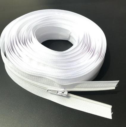 Fermeture éclair au mètre maille 3mm nylon blanc + curseur