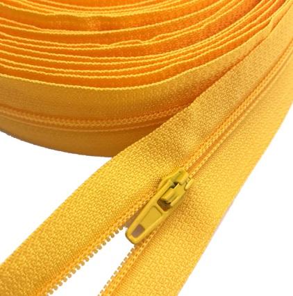 Fermeture éclair au mètre maille 3mm nylon jaune+ curseur