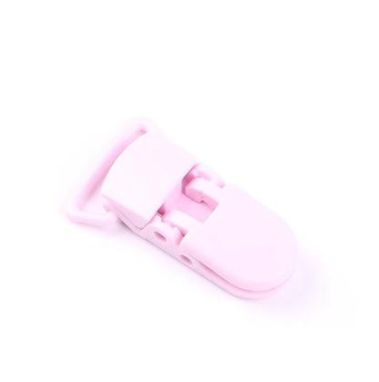 Pince attache tétine plastique Rose pâle