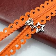 Fermeture non séparable dentelle étoile 25 cm orange